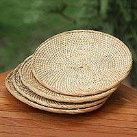 Natural fiber serving plates, 'Lombok Moon' (set of 4) - Set of 4 Handwoven Natural Fiber Serving Plates from Bali