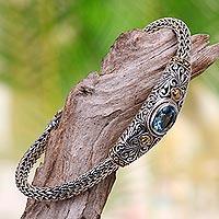 Gold accent blue topaz braided bracelet, 'Bedugul Garden' - Handcrafted Balinese Gold Accent Blue Topaz Silver Bracelet