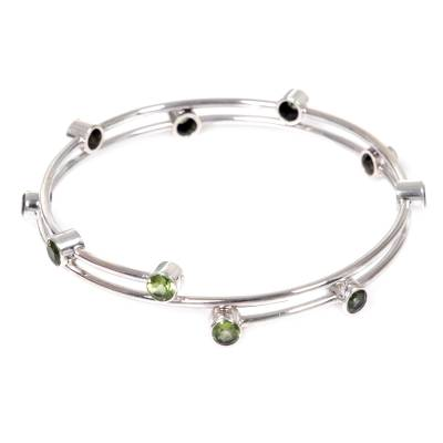 Peridot bangle bracelet, 'Orchid Twist in Green' - Hand Made Sterling Silver Peridot Bangle Bracelet Indonesia