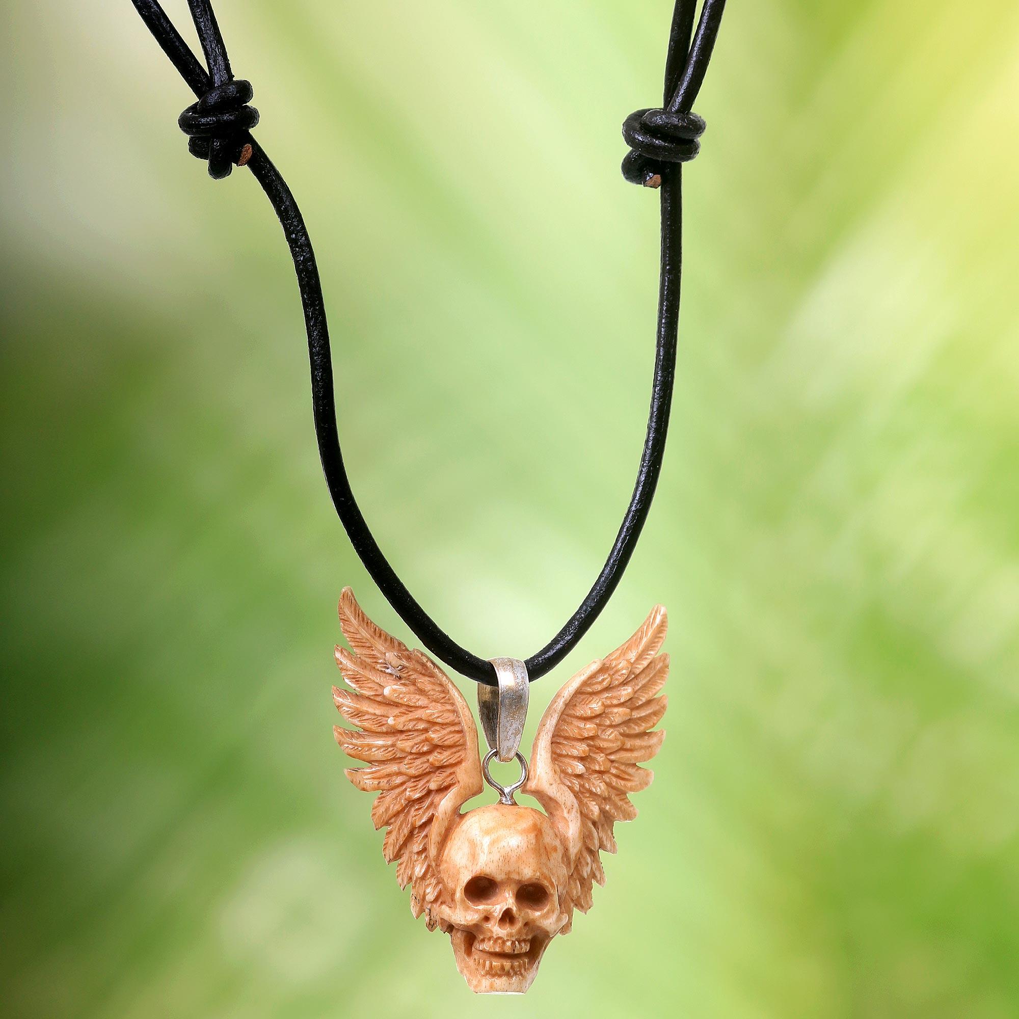 Hand Carved Bone Pendant Necklace Of A Skull From Indonesia Flying Skull Novica