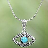 Sterling silver pendant necklace, 'Azure Gaze' - Handcrafted Sterling Silver Reconstituted Turquoise Necklace