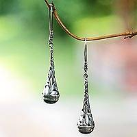 Onyx dangle earrings, 'Gleaming Paddy' - Handmade Onyx and Sterling Silver Earrings from Indonesia