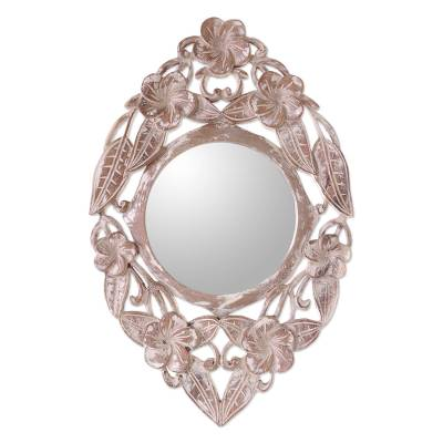 Wood wall mirror, 'Jembrana Frangipani' - Hand-Carved Wood Round Floral Wall Mirror from Bali