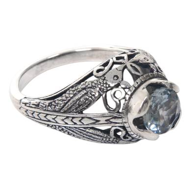 Blue topaz cocktail ring, 'Starling Romance' - Balinese Sterling Silver and Blue Topaz Bird Theme Ring