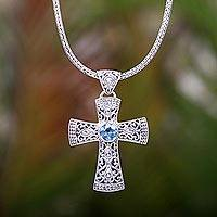 Blue topaz pendant necklace, 'Tropical Cross' - Balinese Silver Cross Necklace with Faceted Blue Topaz