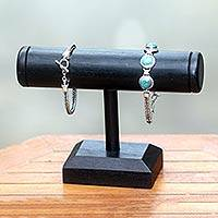 Wood bracelet holder, 'Chinaberry Black' (single) - Handcrafted Black Wood Bracelet Holder Stand