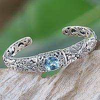 Blue topaz cuff bracelet, 'Sacred Garden in Blue' - Blue Topaz and Sterling Silver Cuff Bracelet from Indonesia