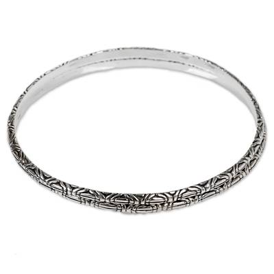 Sterling silver bangle bracelets, 'Indonesian Moon' (pair) - Two 925 Sterling Silver Handmade Engraved Bangles from Bali
