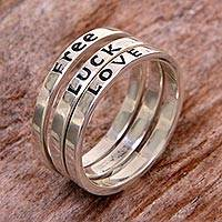 Sterling silver stacking rings, 'Free Luck Love' (set of 3) - Balinese Inspirational Silver Stacking Rings (Set of 3)