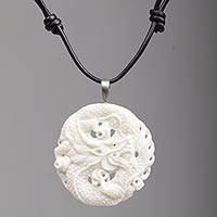 Bone pendant necklace, 'Guard Dragon' - Hand Carved Bone Pendant Necklace Dragon from Indonesia