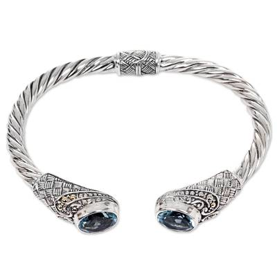 Gold accented blue topaz cuff bracelet, 'Sterling Rope' - Blue Topaz Sterling Silver Cuff Bracelet from Indonesia