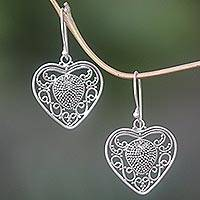 Sterling silver dangle earrings, 'Heart-Shaped Offering' - Hand Made Sterling Silver Heart Dangle Earrings Indonesia