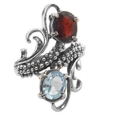 Garnet and blue topaz cocktail ring, 'Magical Union' - Garnet and Blue Topaz Cocktail Ring from Indonesia