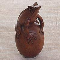 Wood sculpture, 'Proud Frog' - Hand Carved Suar Wood Frog on Pebble Sculpture
