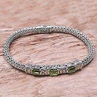 Gold accent peridot braided bracelet, 'Bedugul Temple' - Peridot and Sterling Silver Bracelet with 18k Gold Accents