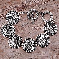Sterling silver link bracelet, 'Frangipani Altar' - Sterling Silver Handcrafted Disc Link Bracelet