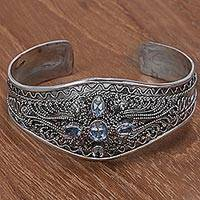 Blue topaz cuff bracelet, 'Directions' - Hand Crafted Sterling Silver and Blue Topaz Cuff Bracelet