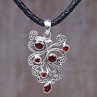 Garnet pendant necklace, 'Tropical Fern' - Sterling Silver and Garnet Pendant Necklace from Indonesia