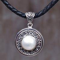 Sterling silver pendant necklace, 'Floral Ring' - Sterling Silver and Leather Cord Pendant Necklace Indonesia