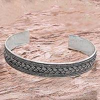 Sterling silver cuff bracelet, 'Romance After Dark' - Handcrafted Balinese Sterling Silver Rope Motif Bracelet