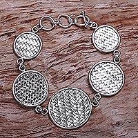 Sterling silver link bracelet, 'Bali Halo' - Indonesian Sterling Silver Toggle Clasp Woven Bracelet