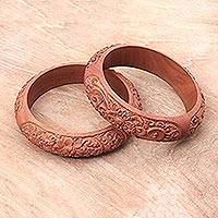 Wood bangle bracelets, 'Bali Blossom' (pair) - Pair of Balinese Hand-Carved Sawo Wood Bangle Bracelets