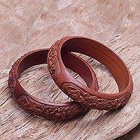 Wood bangle bracelets, 'Floral Intrigue' (pair) - Hand Carved Floral Wood Bangle Bracelets from Bali (Pair)