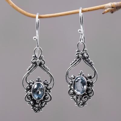Blue topaz dangle earrings, 'Sigh' - Bali Artisan Jewelry Blue Topaz Sterling Silver Earrings