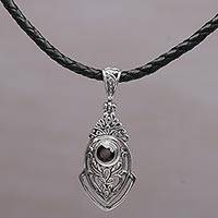 Garnet pendant necklace, 'Bali Amulet in Red' - Sterling Silver and Garnet Pendant Necklace from Indonesia