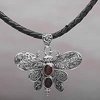 Garnet pendant necklace, 'Bali Moth in Red' - Garnet and Leather Moth Pendant Necklace from Indonesia