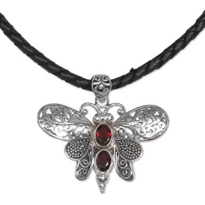 Garnet pendant necklace, 'Bali Moth in Red' - Garnet and Leather Moth Pendant Necklace from Indonesia
