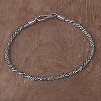 Sterling silver braided bracelet, 'Woven Secret' - Hand Crafted Sterling Silver Braided Bracelet from Indonesia
