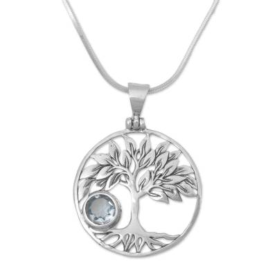 Blue topaz pendant necklace, 'Sandalwood Shade' - Topaz and Sterling Silver Tree Pendant Necklace from Bali