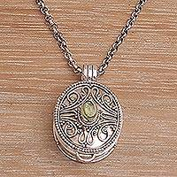 Peridot locket necklace, 'Hidden Soul' - Sterling Silver and Peridot Locket Necklace on Silk Cord