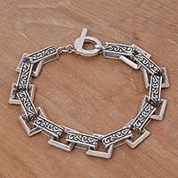Sterling silver link bracelet, 'Daring Swirls' - Indonesian Sterling Silver Link Bracelet with Swirl Motifs