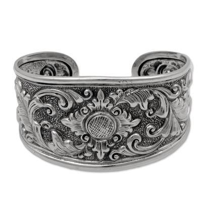 Sterling silver cuff bracelet, 'Courageous Soul' - Sterling Silver Repousse Cuff Bracelet from Indonesia