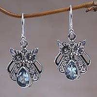 Blue topaz dangle earrings, 'Owl's Tears' - Blue Topaz and Sterling Silver Owl Earrings from Indonesia