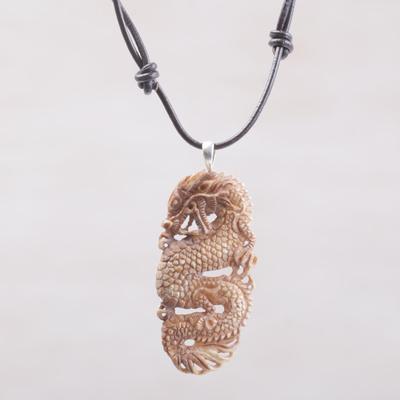 Bone pendant necklace, 'Snarling Dragon' - Bone and Leather Dragon Pendant Necklace from Indonesia