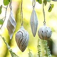 Wood ornaments, 'Holiday Ambassadors' (set of 4) - Four White Distressed Albesia Wood Ornaments from Bali