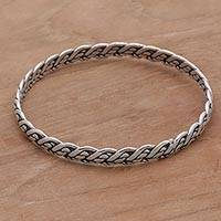 Sterling silver bangle bracelet, 'Woven Twine' - Sterling Silver Braided Bangle Bracelet from Indonesia