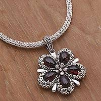 Garnet pendant necklace, 'Bougainvillea Flower' - Garnet and Sterling Silver Floral Pendant Necklace from Bali