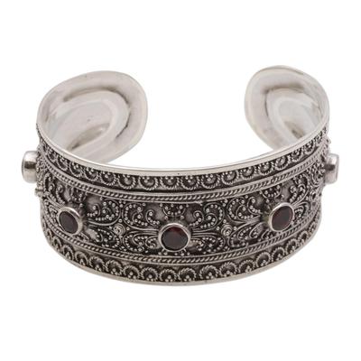 Garnet cuff bracelet, 'Uluwatu Altar' - Balinese Sterling Silver Cuff Bracelet with Garnet 3.5 Cts