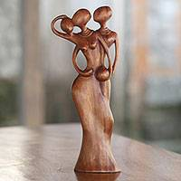 Wood sculpture, 'Love for Family' - Hand Carved Suar Wood Sculpture of a Passionate Family