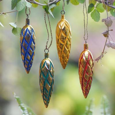 Wood ornaments, 'Golden Cones' (set of 4) - Four Handcrafted Gold Tone Albesia Wood Ornaments from Bali
