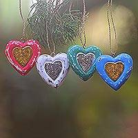 Wood ornaments, 'Festive Love' (set of 4) - Four Heart Shaped Multicolored Bali Albesia Wood Ornaments