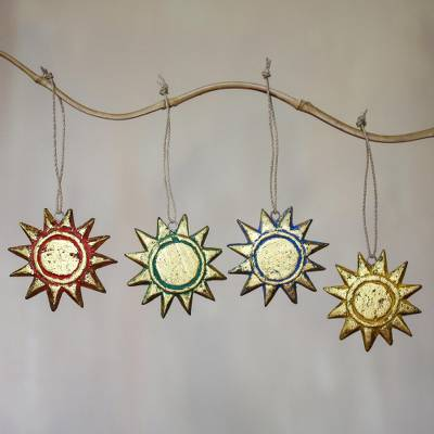 Wood ornaments, 'Sunny Holiday' (set of 4) - Four Gold Tone Albesia Wood Sun Ornaments from Bali