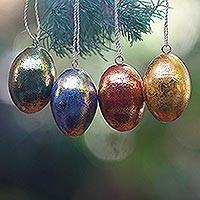 Wood ornaments, 'Golden Eggs' (set of 4) - Four Gold Tone Albesia Wood Egg Shaped Ornaments from Bali
