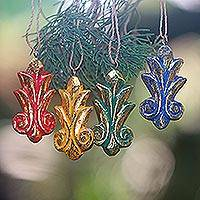 Wood ornaments, 'Festive Fleur-de-Lis' (set of 4) - Four Gold Tone Albesia Wood Ornaments by Balinese Artisans