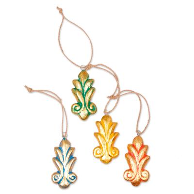 Wood ornaments, 'Festive Fleur-de-Lis' (set of 4) - Four Gold Tone Albesia Wood Ornaments by Balinese Artisans