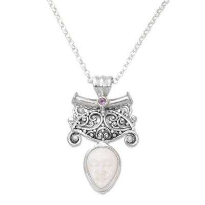 Amethyst pendant necklace, 'Janger Solo' - Amethyst and Bone Pendant Necklace by Balinese Artisans
